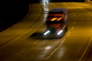 Speed-Blur-Truck-on-Interstate-at-Night